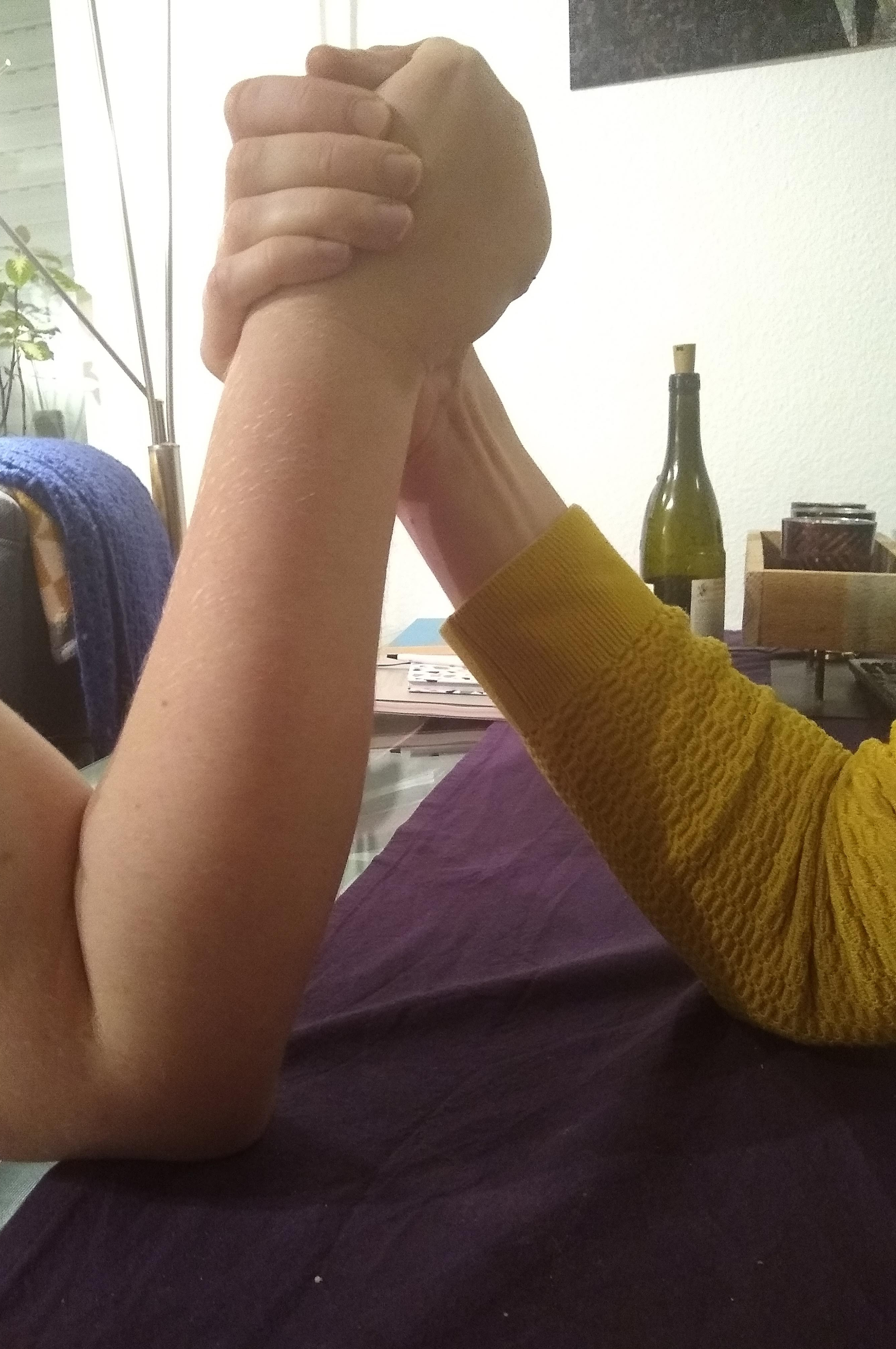 Two arms locked in an arm wrestle