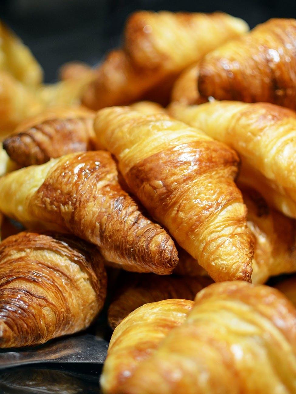 Piles of freshly baked croissants.